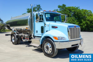 blue fuel oil truck curb side view